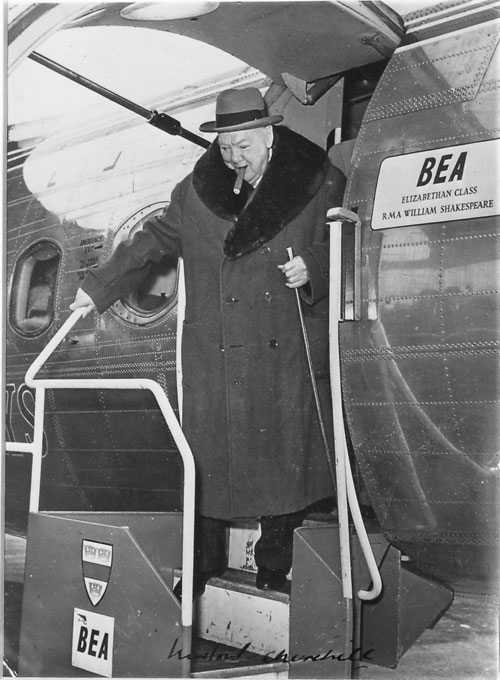 Signed photo of Churchill exiting airplane 1957